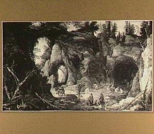 Rotslandschap met figuren bij een grot