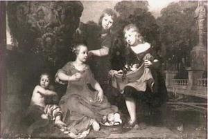 Vier kinderen in een tuin
