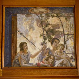 Twee vrouwen en twee kinderen bij een venster