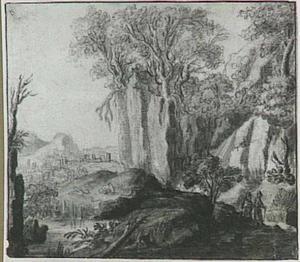 Rotslandschap met rivier en stad op de achtergrond