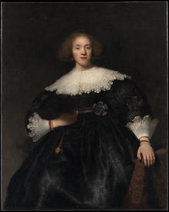 Portret van een jonge vrouw met een waaier
