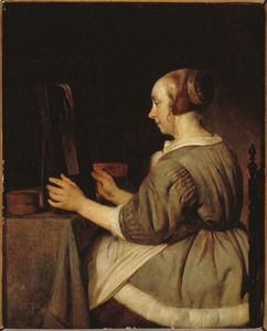Vrouw kijkend in een spiegel