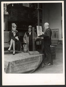 Kees van Dongen met model in zijn atelier in de Rue de Couvalle, Parijs