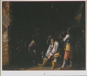 Wachtlokaal met soldaten die zich aankleden