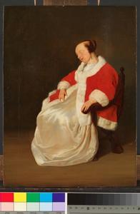 Slapende jonge vrouw in een stoel