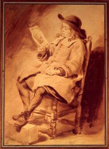 Zittende jongen die een tekening bekijkt