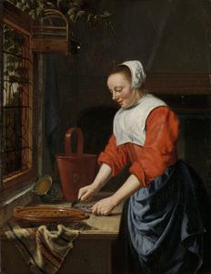 Dienstmeid in een keuken