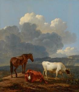 Een paard en twee koeien in een berglandschap