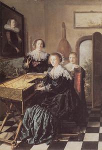 Groepsportret van twee musicerende vrouwen en een meisje in een interieur