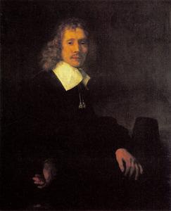 Portret van een aan een tafel zittende man