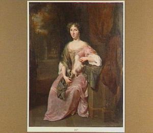 Portret van een vrouw, zittend in een park