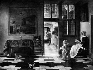 Vrouw met boek en kind met hoepel in een interieur