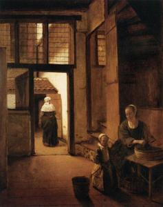 Vrouw die groenten bereidt en een kind in een interieur