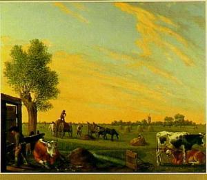 Hooiende boeren met vee in de wei