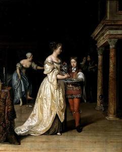 Interieur met een handenwassende vrouw