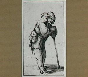 Staande, op een stok leunende man