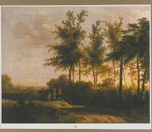 Landschap met eendenjagers bij een bosrand
