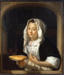 Jonge vrouw met een wafel in een vensteropening