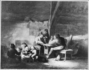 Etend en kaartspelend boerengezelschap in een interieur