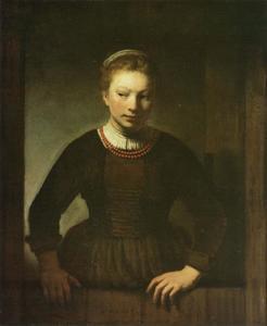 Jonge vrouw aan de onderdeur