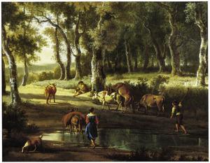 Herders met vee bij een poel in het bos