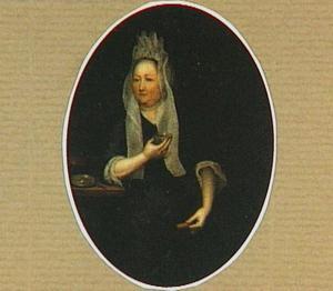 Portret van een vrouw die thee drinkt