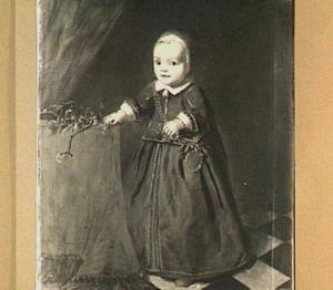 Portret van een kind naast een vruchtentak op een tafel