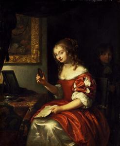 Jonge vrouw met een brief en medaillon