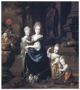 Familie portret -van een moeder met drie kinderen in een tuin