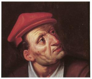 Kop van een man met een rode muts