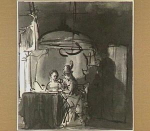 Een man en een vrouw zittend aan een tafel