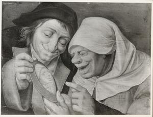 Lachend paar met een spiegel