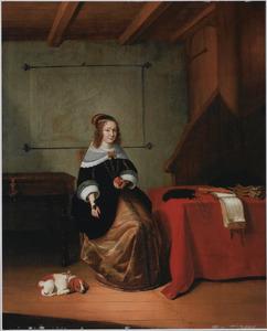 Jonge vrouw zittend in interieur
