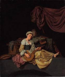 Jonge vrouw bespeelt een citer