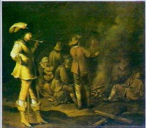 Soldaten en boeren rond een kampvuur