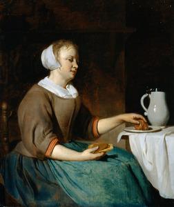 Etende jonge vrouw aan tafel