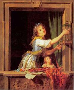 Jonge vrouw laat vogel vrij uit kooi