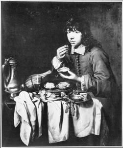 Jongen eet oesters van een gedekte tafel