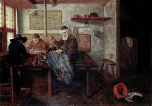 Schoenmaker met twee assistenten in het atelier