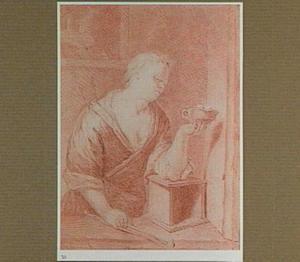 Vrouw blaast op hete kolen in een test, in een vensteropening