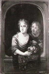 Een meisje en een jongen met een mand bloemen in een venster
