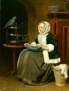 Handwerkende vrouw met papegaai