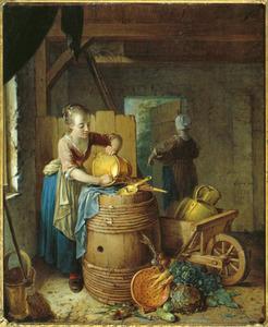 Een jonge vrouw schuurt een emmer in een schuur