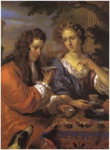 Elegant paar drinkt thee in een park