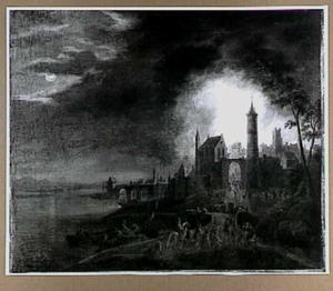 Brandende stad bij nacht