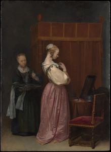 Jonge vrouw aan haar toilet, met een dienstmeid