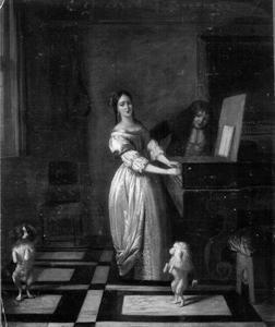 Klavecimbel spelende vrouw met een man en twee dansende hondjes