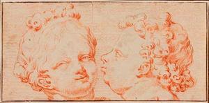 Gebeeldhouwde kopjes van een jongen en meisje