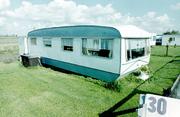 """Camping """"De Striene"""", huisje nr. 30 en 31."""