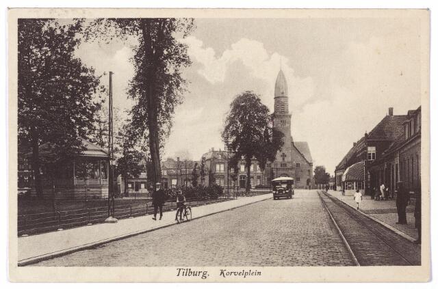 001515 - Openbaar vervoer. Korvel met links de kiosk, in de verte de nieuwe St. Antoniuskerk, ingewijd op 14 juli 1924, links van de kerk de in 1904 gebouwde pastorie. Rechts de rails van de tram naar Goirle, Hilvarenbeek en Esbeek. Ofschoon deze tramverbinding reeds op 15 september 1934 is opgeheven, duurt het tot september 1952 voordat de tramrails op Korvel verwijderd zijn.